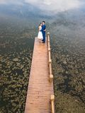 Loving couple on the dock at the lake stock images