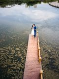 Loving couple on the dock at the lake royalty free stock photography