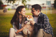 Loving couple and dog Royalty Free Stock Photography