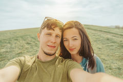 Loving couple doing selfie in the mountains Royalty Free Stock Photo