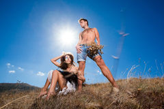 Loving couple in the dried field under the sun Royalty Free Stock Photos