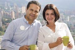 Loving couple drinking cafe Stock Images