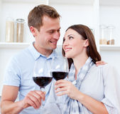 Loving couple drinking red wine Stock Images