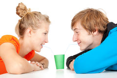 Loving couple drinking with straws Stock Photos