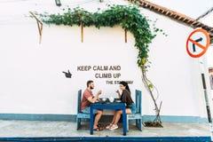Loving couple drinking tea in the street stock image