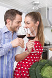 Loving couple drinking wine in the kitchen Stock Photography