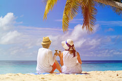 Loving couple drinking wine at tropical beach Stock Images
