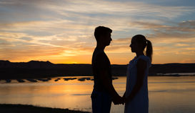 Loving Couple at Dusk Stock Images