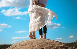 Woman in love man top of a hill royalty free stock images