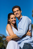 Loving couple embracing each other against clear blue sky Stock Photography
