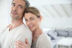 Loving couple embracing at home Royalty Free Stock Photography