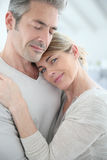 Loving couple embracing at home Stock Image