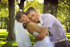 Loving couple embracing. In park. happy newlyweds Royalty Free Stock Image