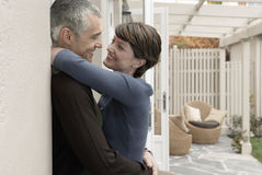 Loving Couple Embracing At Porch Stock Photos