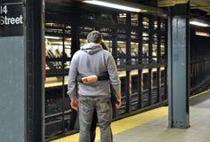 Loving couple embracing at subway station stock images