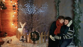 A loving couple enjoy each other against a background of fairytale decorations. Christmas and New Year theme. A loving couple enjoy each other against a stock footage