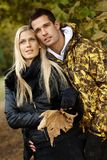 Loving couple enjoying autumn forest Royalty Free Stock Images