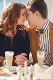 A loving couple enjoying an coffee in the café Stock Photo
