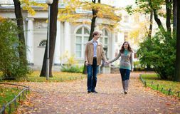 Loving couple enjoying a fall day in park Royalty Free Stock Photo