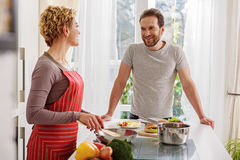 Loving couple enjoying happy moments in kitchen Royalty Free Stock Image