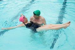 Loving couple enjoying in swimming pool Stock Image