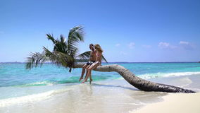 A loving couple enjoying vacation on a tropical beach. Slow Motion. A loving couple enjoying vacation on a tropical beach. Maldives. Slow Motion stock video footage