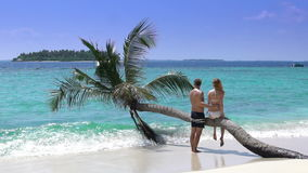 A loving couple enjoying vacation on a tropical beach. Slow Motion. A loving couple enjoying vacation on a tropical beach. Maldives. Slow Motion stock video