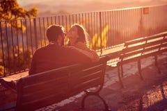 Loving couple enjoys at the sunset