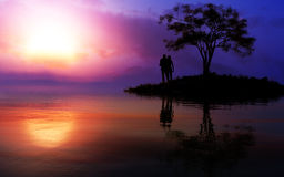 Loving Couple On Epic Fantasy Warm Sunset. Warm and friendly sun rising or setting over a lake with a romantic couple on a small island with tree with fine Royalty Free Stock Photos