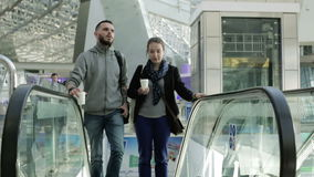 Loving couple on the escalator at the airport. stock video footage