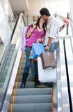 Loving couple on escalators Stock Photography