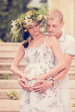 A loving couple expecting a baby in the park Royalty Free Stock Images