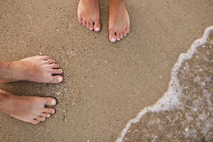 Loving couple feet in the sand Royalty Free Stock Image
