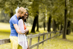 Loving couple by the fence Royalty Free Stock Image