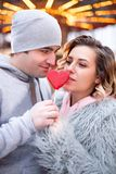 Loving couple in the festive Christmas city celebrate the New Year. Romantic walk in winter royalty free stock photography