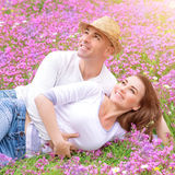 Loving couple on the field Stock Photography