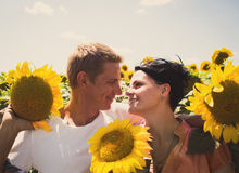 Loving couple in a field Stock Photos