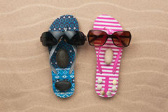 Loving couple of flip flops on the sand Royalty Free Stock Photo