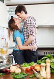 Loving couple flirting  in domestic kitchen Stock Photography