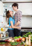 Loving couple flirting  in  kitchen Royalty Free Stock Image