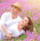 Loving couple on the  floral field Stock Photos