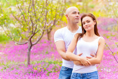 Loving couple on floral field Stock Photo