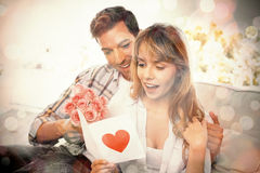 Loving couple with flowers and greeting card Royalty Free Stock Images
