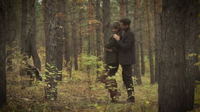 Loving couple in the forest. Beginning of autumn. He hugs his girlfriend and played with her hair. They are in love and. Happy. A loving couple posing for a stock video
