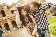 Loving couple in front of the Colosseum in Rome. While raining royalty free stock images
