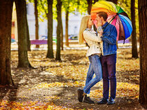 Loving couple full height on a date kissing under stock images