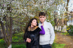 A loving couple is in a garden royalty free stock photos