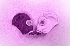 Loving couple of gas masks Royalty Free Stock Photo