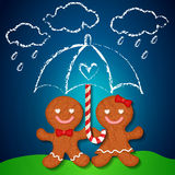 Loving couple of gingerbread cookies and sugar cane Royalty Free Stock Photo