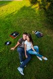 Loving couple on the grass lying. stock photography